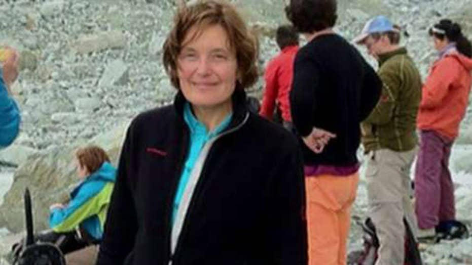 Greek coroner says dead woman believed to be American scientist was victim of 'criminal act'