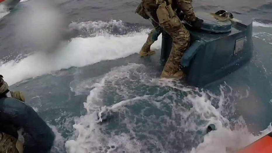 Raw video: Coast Guard sailors jump onto relocating drug bootlegging semi-submersible vessel, officials saynbsp;