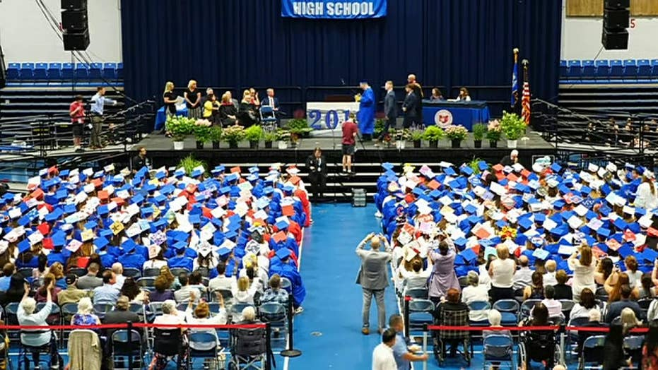 Graduating seniors during Carmel High School reason wordless turn of acclaim out of honour for autistic graduate