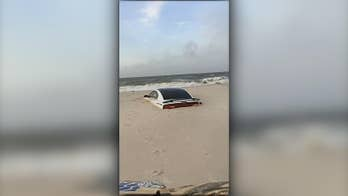 Tropical Storm Barry ruins man's Alabama vacation, sinks Dodge Charger into the sand