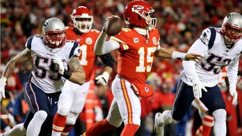 KC Chiefs' Patrick Mahomes launches football out of stadium