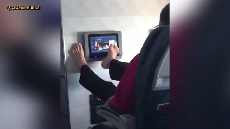 WATCH: Video of airline passenger operating screen with toes goes viral