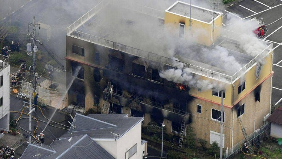 Man under arrest in Japan after fire leaves 33 people dead
