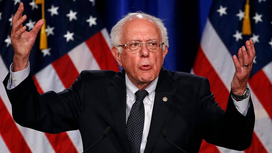 Bernie Sanders under fire from own staff amid push for $15 minimum wage