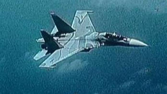 Venezuelan fighter jet 'aggressively shadowed' Navy aircraft over Caribbean Sea, US military says