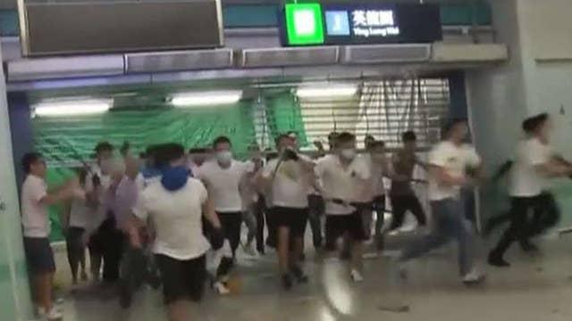 Masked attackers storm Hong Kong subway, attack commuters following pro-democracy march