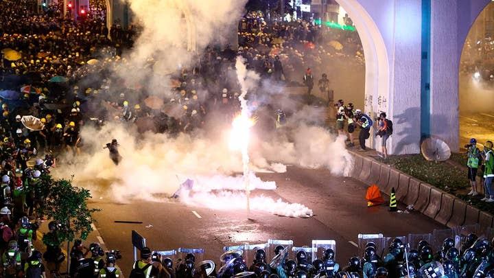 Hong Kong police grapple with more pro-democracy demonstrators.