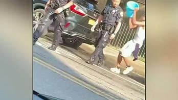 New York police slam videos showing officers pelted with objects, drenched with water: 'reprehensible'