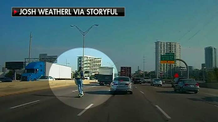 Man riding rental scooter on Texas interstate at rush hour startles some