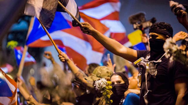 Celebrations spill into streets of San Juan as Puerto Rico governor resigns