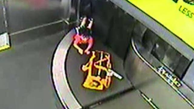 Toddler falls through airport baggage drop after climbing onto conveyor belt