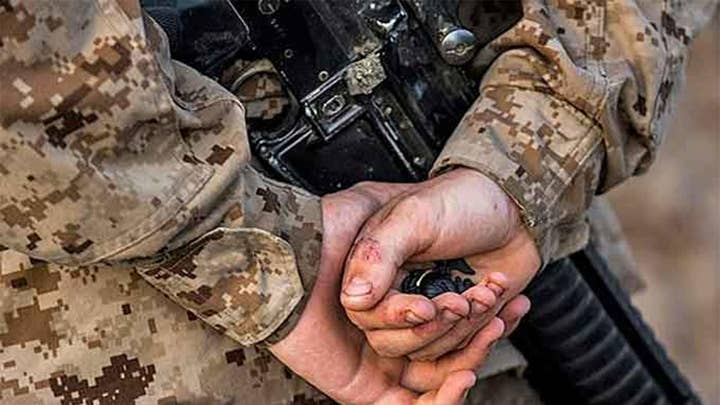 16 Marines arrested for alleged involvement in various illegal activities including human smuggling