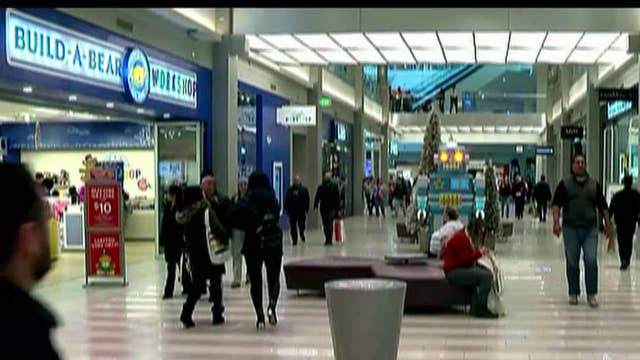 Strong consumer spending grows economy 2.1 percent