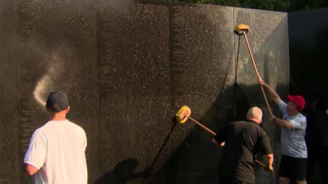 Bipartisan group of lawmakers hand-wash Vietnam Veterans Memorial