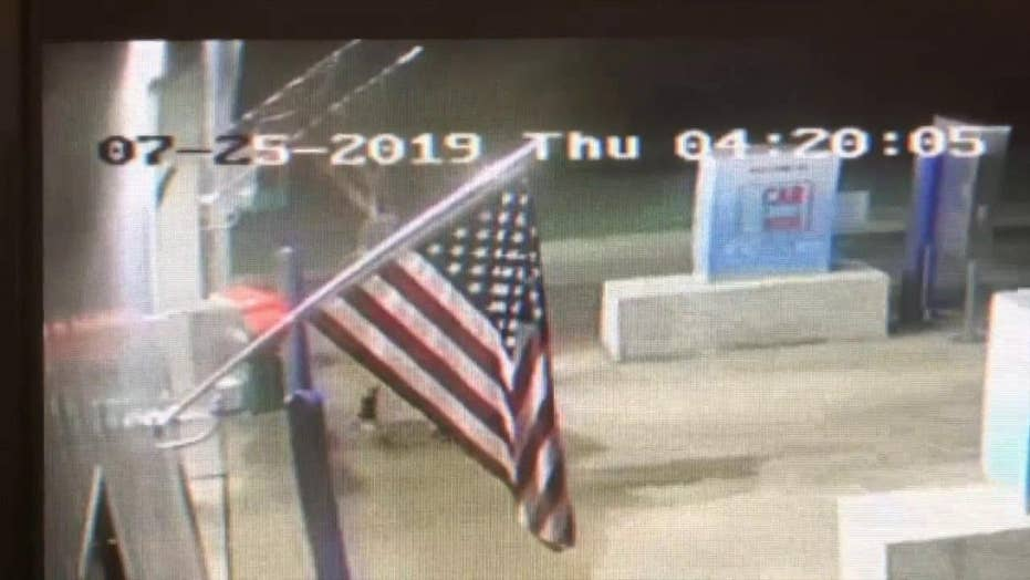 Teen caught stealing the American flag from business taught a lesson by passing out flags