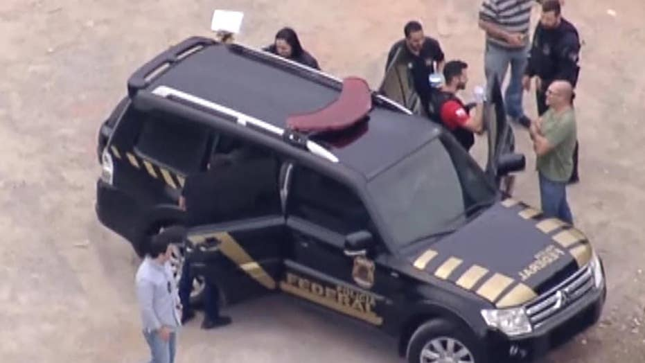 Armed men raid Sao Paulo airport and flee with $30 million in gold