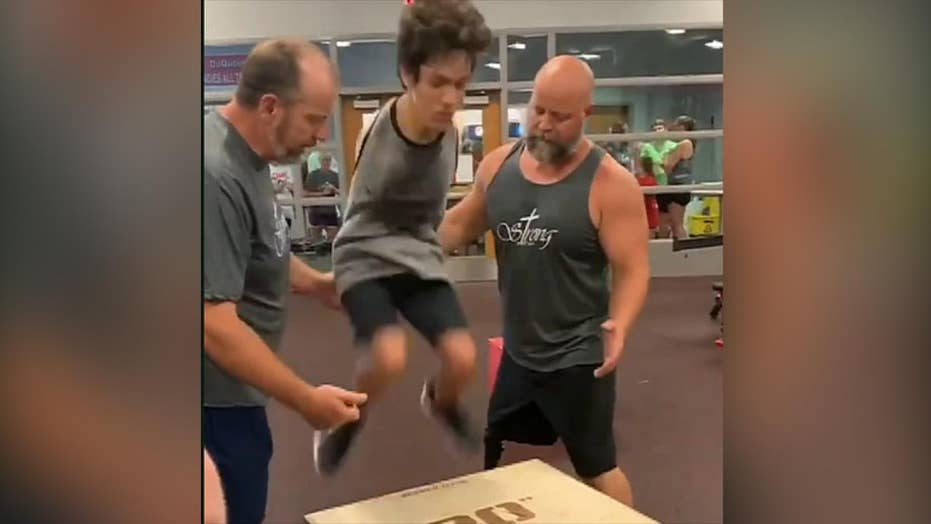 Raw video: Teen athlete without arms performs twenty inch box jump