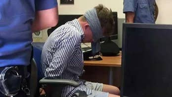 Leaked photo shows teen accused of killing Italian police officer illegally blindfolded at station
