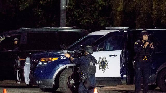 Gilroy shooter described as wearing fatigues, armed with machine gun