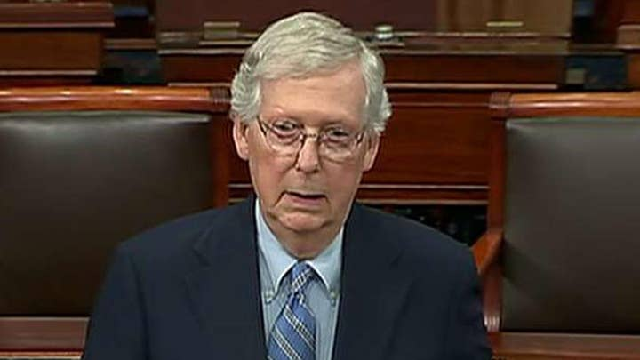 Senate Majority Leader Mitch McConnell defends himself from criticism for blocking election security bills