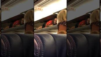 Southwest Airlines flight attendant inside overhead compartment 'perplexes' passenger
