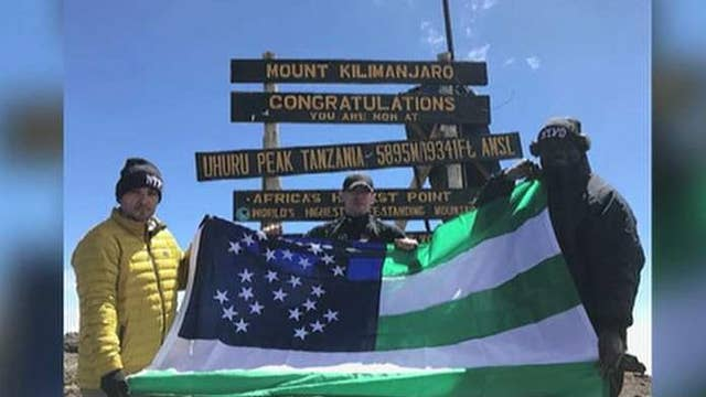 NYPD officers climb Mount Kilimanjaro to raise money for children with cancer