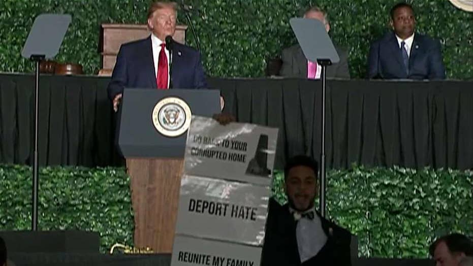 Protester interrupts President Trump's speech at Jamestown anniversary event