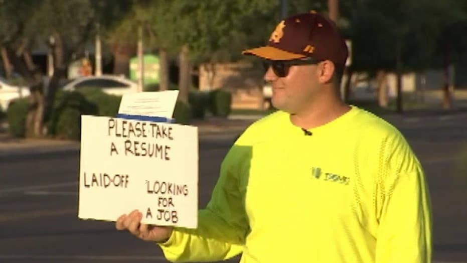 Phoenix panhandler hands out resumes at intersections