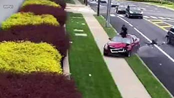 Philadelphia driver jumps out of sunroof after rear-ending car