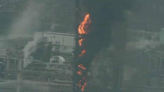 Crews battle fire burning at ExxonMobil oil refinery outside of Houston