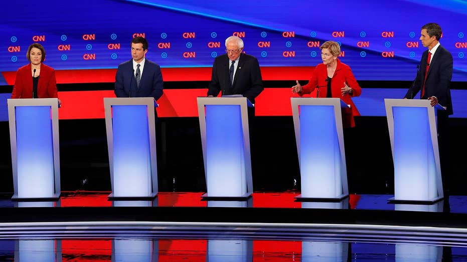 Moderate and progressive candidates clash on debate stage for soul of Democratic Party