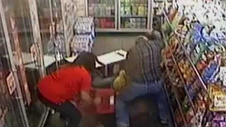 Watch: Gas station hostages fight off their attacker