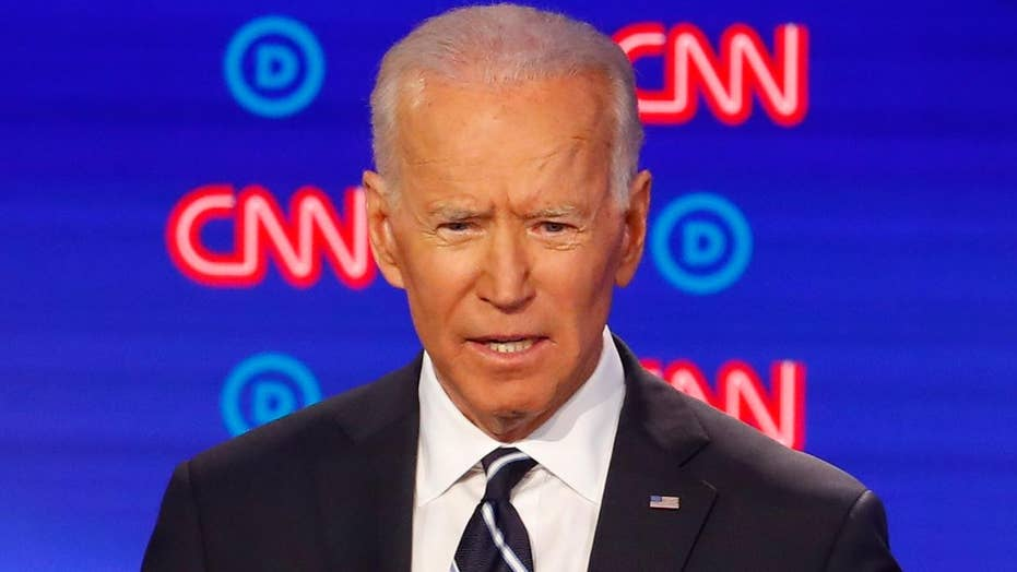 2020 Democrats pile on Joe Biden's record, ties to Obama on debate stage