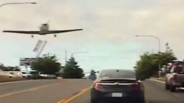 Small plane dodges traffic, makes emergency landing on busy highway