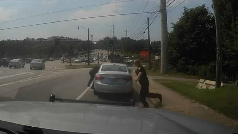 Officer dragged down interstate