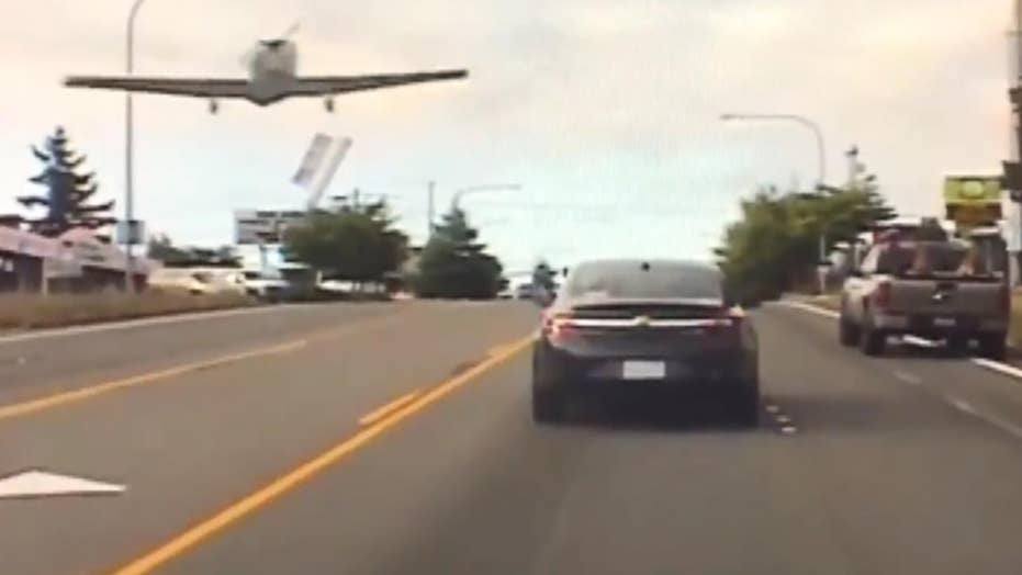 Small plane forced to make emergency landing on busy road