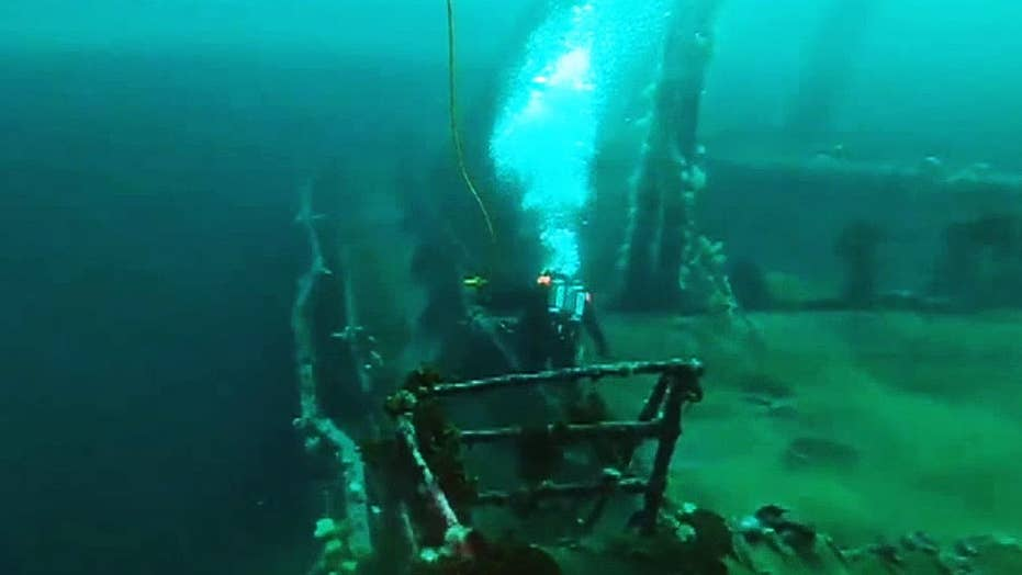 Canadian Navy divers retrieve shells and ammunition from wrecked merchant ships