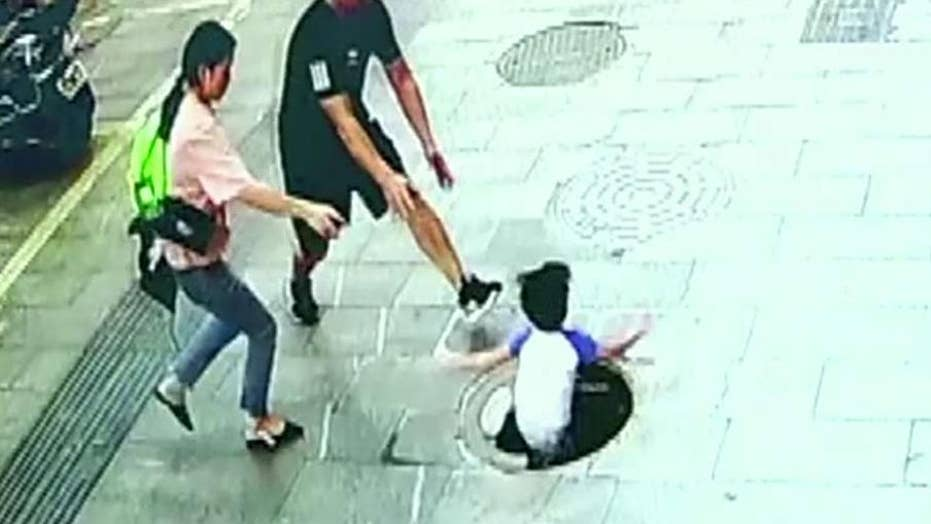 3-year-old falls through manhole in China, dad pulls him out