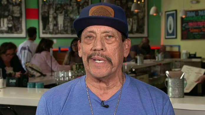 Surveillance video shows Danny Trejo rush to save baby after car crash