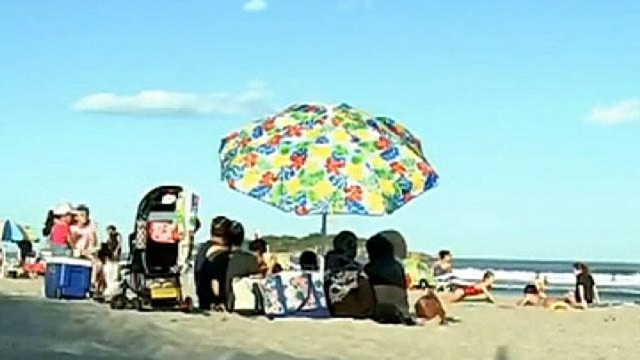 Teen hospitalized after being struck by beach umbrella