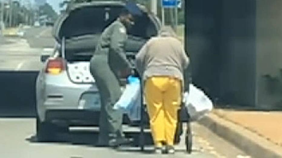 Oklahoma Airman helps elderly woman take home groceries