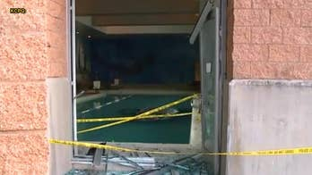 Man crashes car through LA Fitness building, drives straight into pool