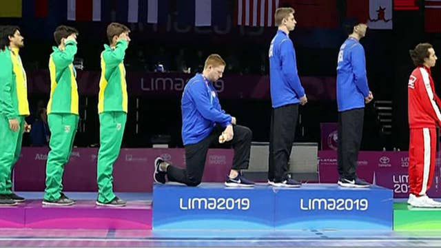 US medalists protest national anthem on world stage