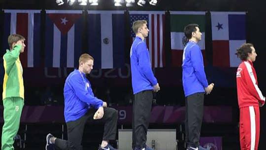 US fencing team kneels for national anthem after winning gold medal
