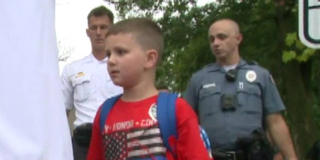 Missouri police officer battling cancer leaves hospital to walk autistic son to first day of kindergarten