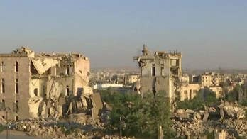 Syrian troops recapture two key villages as deadly fighting continues