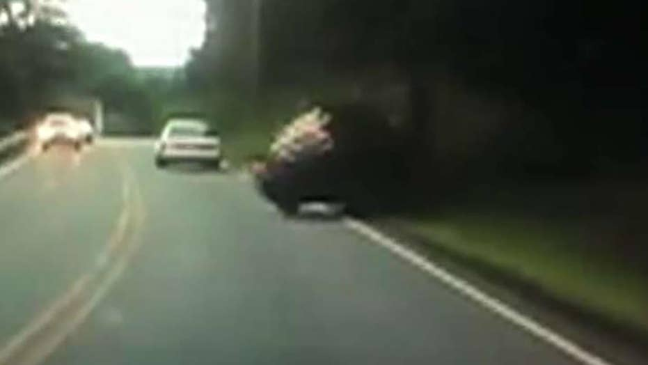 Texting driver hits pole, flips over in Massachusetts