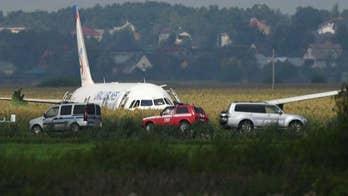 Russian pilots make emergency landing in cornfield