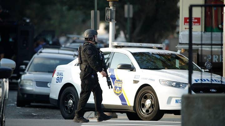 Philadelphia shooting suspect barricaded as officers urge surrender