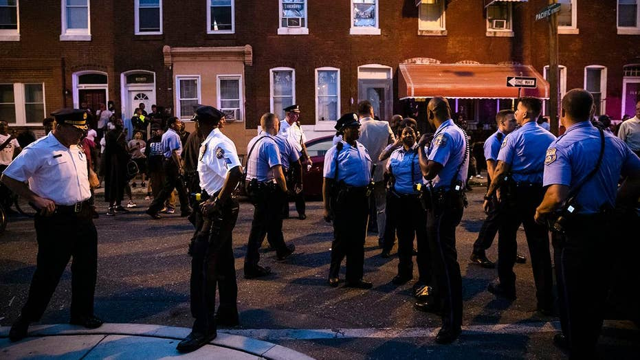 Philadelphia residents taunt police officers during standoff